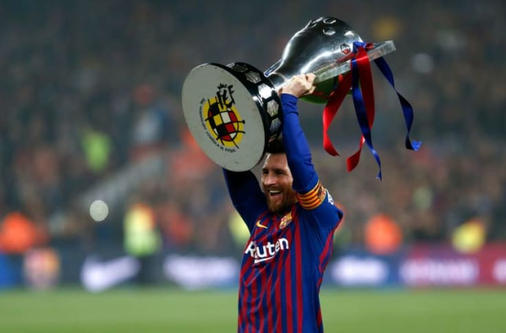 Lionel Messi carrying a trophy